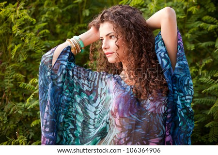 curly hair woman portrait outdoor summer day - stock photo