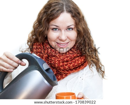 Curly hair woman pouring hot water from the kettle into a cup, isolated on white background - stock photo