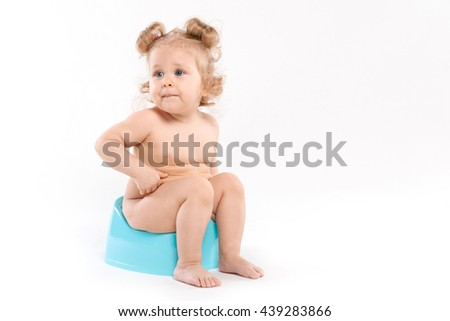 curly-haired girl on the pot on a white background  - stock photo