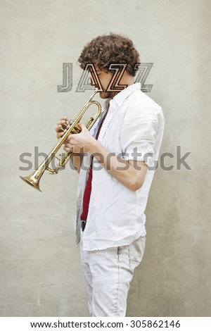 curly haired man plays jazz trumpet stock photo 346826231