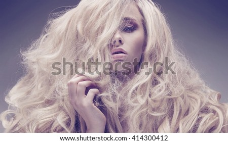 Curly haired woman, fashion type portrait