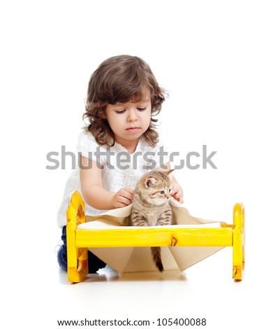 curly kid girl playing with kitten as mother with baby