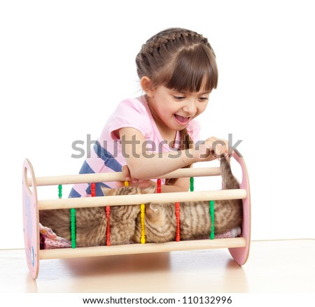 curly kid girl playing with kittens - stock photo