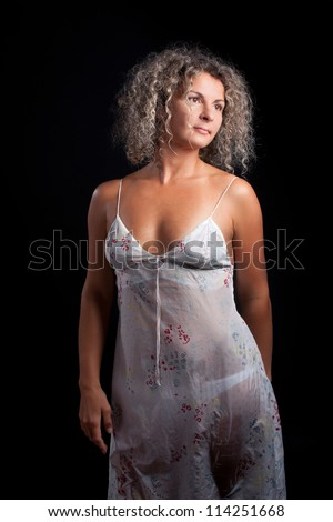curly mature woman wearing lingerie posing stock photo (safe to use