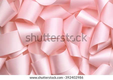 Curly pink ribbon,ribbon background - stock photo