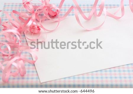 Curly pink ribbons on a gift for a Girl's baby shower. - stock photo