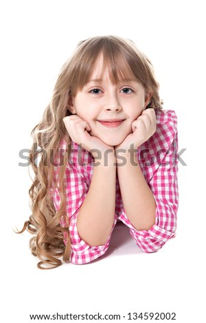 curly smiling girl lies on a floor isolated over white - stock photo