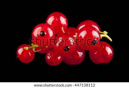 currants on a black background closeup