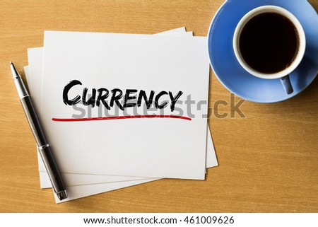 Currency - handwriting on papers with cup of coffee and pen, finance concept