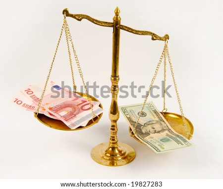 Currency on scale - stock photo