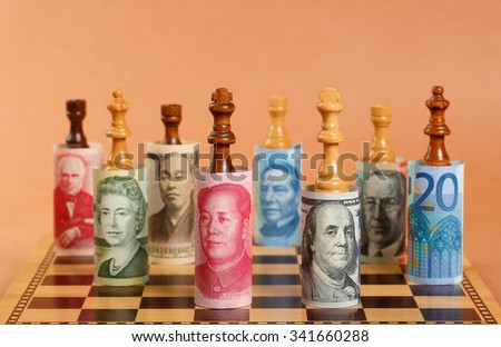 Currency War. Photo Shows Banknotes from Different Countries on a Chess Board.