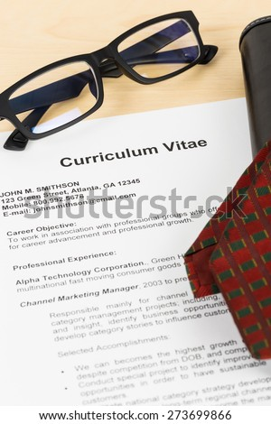 Curriculum vitae or CV with glasses, organizer and neck tie; concept job applying - stock photo
