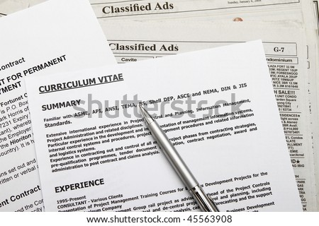 Curriculum vitae with employment contract found on classified ads. - stock photo