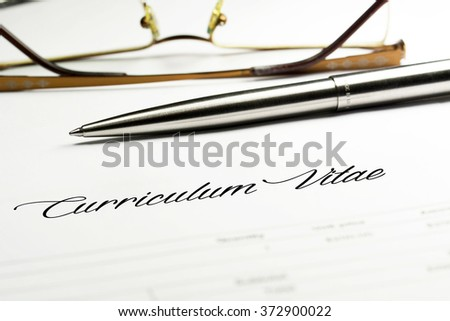 Curriculum vitae with pen and reading glasses - stock photo