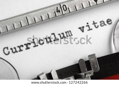 Curriculum vitae written on an old typewriter concept for job search - stock photo
