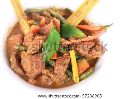 Curry Beef with curry leaf isolated on white background - stock photo