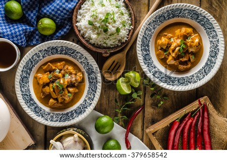 Curry chicken with basmati rice, delicious and spicy food, fresh herbs, very simple to make - stock photo