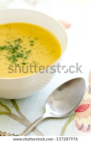Curry, coconut, butternut squash soup in a bowl. - stock photo