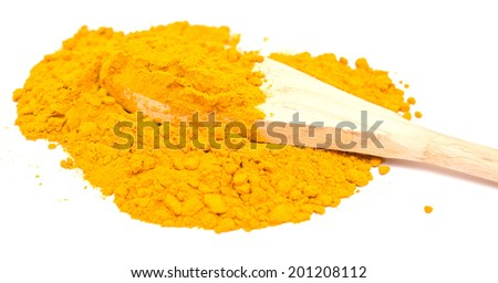 curry powder in wooden spoon on white background