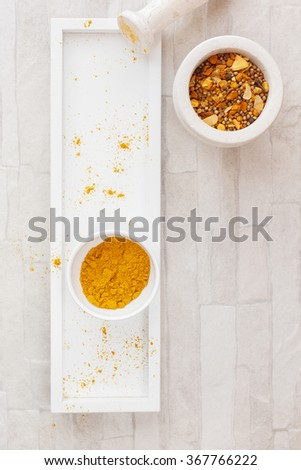 Curry powder  on tray .Home-made curry powder being crushed in a mortar.  Top view, blank space, vintage toned image. Natural light - stock photo