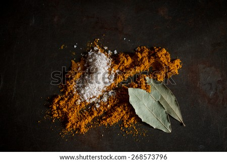 curry powder with sea salt and bay leaf  image soft focus , put on grunge metal background - stock photo