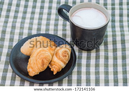 Curry puff,a kind of sweet in Thailand, and a cup of hot cocoa - stock photo