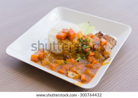 Curry Rice on wooden background - stock photo