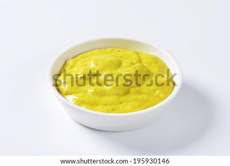 Curry sauce in a porcelain bowl - stock photo