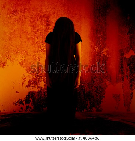 Curse of the witch,Mysterious girl in black dress standing in abandon place,Horror background for halloween concept and movie poster project - stock photo