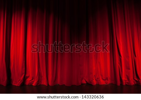 Curtain from the theater with a spotlight as background - stock photo