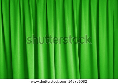 curtain of cinema stage background, green dramatic tone - stock photo