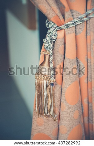 curtain with an ornament (Vintage filter effect used) - stock photo