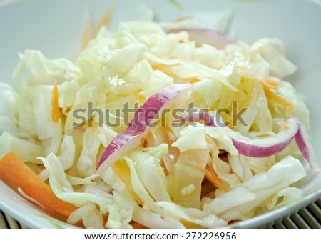 Curtido - lightly fermented cabbage relish. typical in Salvadoran cuisine and  Central American countries.made with cabbage, onions, carrots, and sometimes lime juice