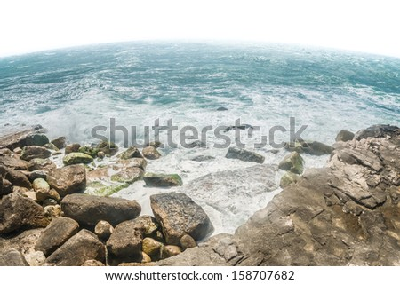 curvature of the earth and crashing ocean waves seascape - stock photo