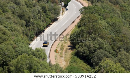 Curve of a hilly road in Barcelona, Catalonia, Spain, July 2016