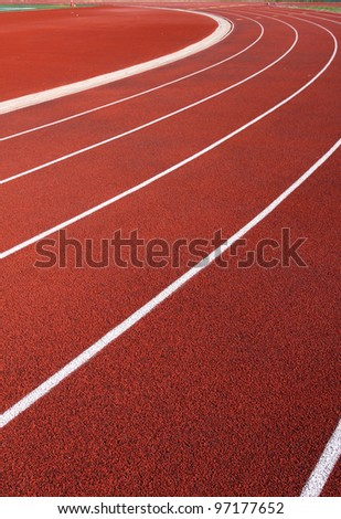 Curve of a Red Running Track - stock photo