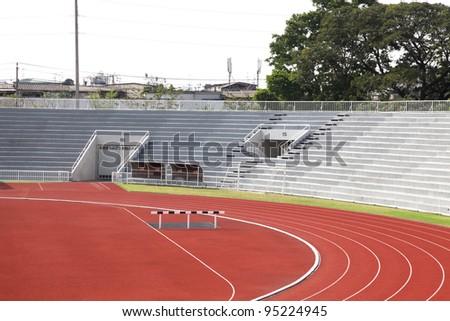Curve of Race Track in Stadium - stock photo