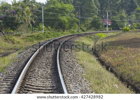 curve of train rail in Thailand - stock photo
