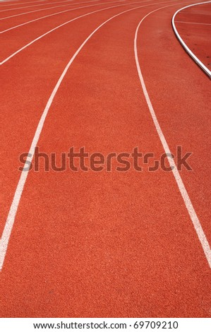 Curve on a red running track - stock photo