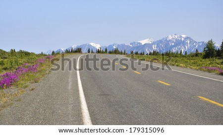 curve on Alaskan highway - stock photo