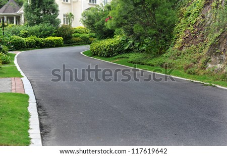 curve road nearby the house. - stock photo