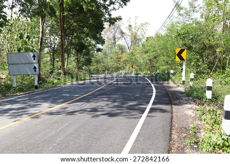Curve road on down hill. - stock photo