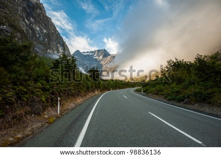 Curve road to the mist - stock photo