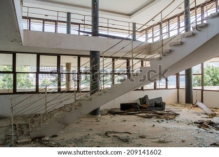 Curve staircase in an abandoned hotel after the war in Croatia - stock photo