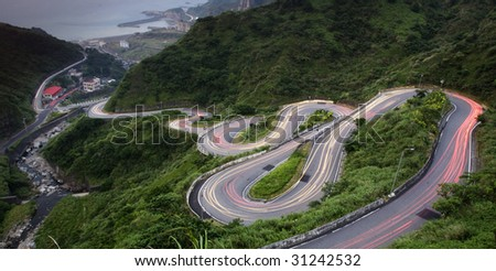 curve with car light - stock photo