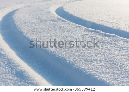curved arc of the track covered with snow