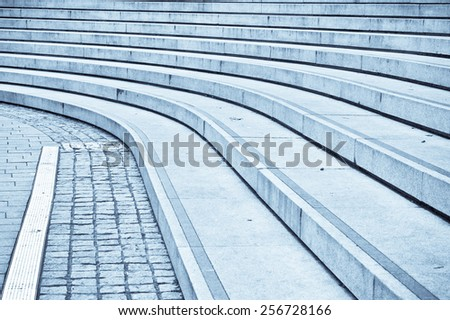 Curved concrete steps as an abstract in blue tones - stock photo