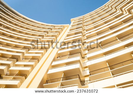 Curved lines of modern building floors towering upwards. - stock photo