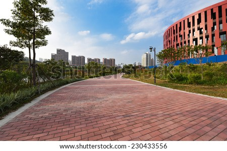 Curved red brick walkway (putian) - stock photo