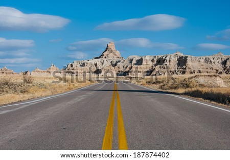 Curved Road in Badlands. Badlands National Park Curved Road - stock photo